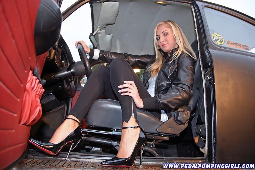 http://www.madmanmovies.com/pics/black_beetle_cranking_in_high_heels_002.jpg